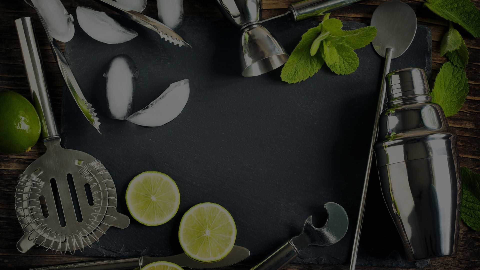 Slate with food and cooking utensils on it