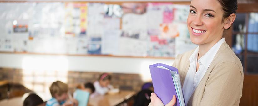 Teacher in front of her classroom