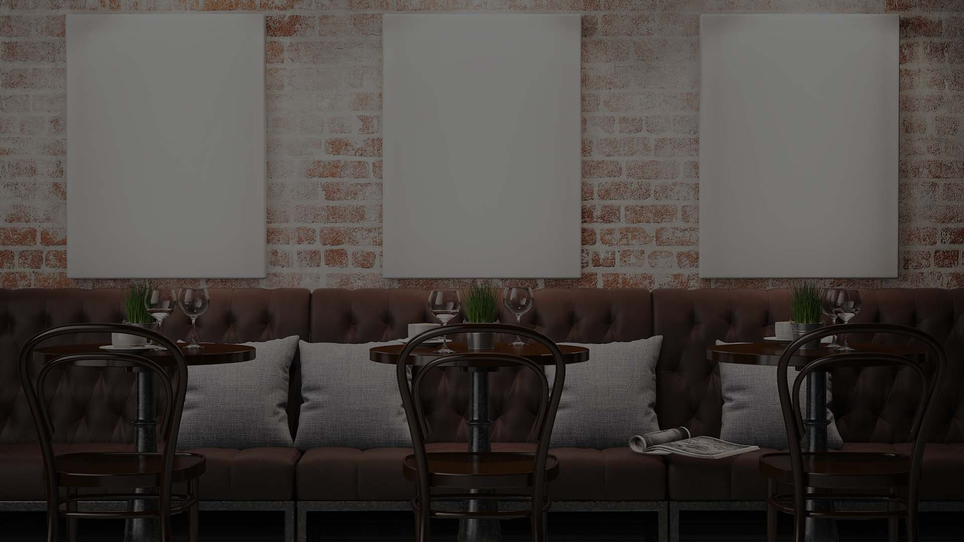 Restaurant with brick wall and blank canvases on it